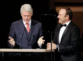 Former President Bill Clinton and actor Kevin Spacey on stage together at the 25th Anniversary Rainforest Fund benefit concert at Carnegie Hall on Thursday, April 17, 2014 in New York. (Photo by Evan Agostini/Invision/AP)