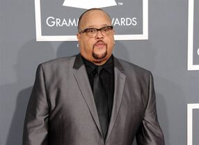 FILE - In this Feb. 10, 2013 file photo shows Fred Hammond at the 55th annual Grammy Awards in Los Angeles. Hammond and Donnie McClurkin are preparing for the Festival of Praise Tour, which spans 31 cities. The tour, which includes Cleveland, Detroit, Miami and Atlanta, kicked off this week as McClurkin recovers from surgery to remove precancerous cells from one of his vocal cords and Hammond recuperates after having a bilateral knee replacement. (Photo by Jordan Strauss/Invision/AP, File)