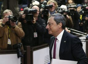President of the European Central Bank Mario Draghi arrives on the second day of an EU summit in Brussels, on Friday, Oct. 24, 2014. EU leaders gather for a two-day summit in which they discuss Ebola, climate change and the economy. (AP Photo/Yves Logghe)