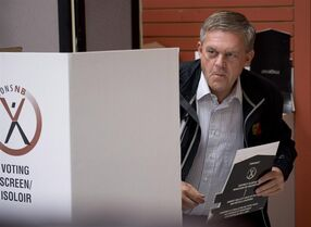 New Brunswick Progressive Conservative Leader David Alward steps away from the voting screen after voting, Monday, September 22, 2014 in Woodstock, N.B. New Brunswick voters are going to the polls in a general election. THE CANADIAN PRESS/Jacques Boissinot