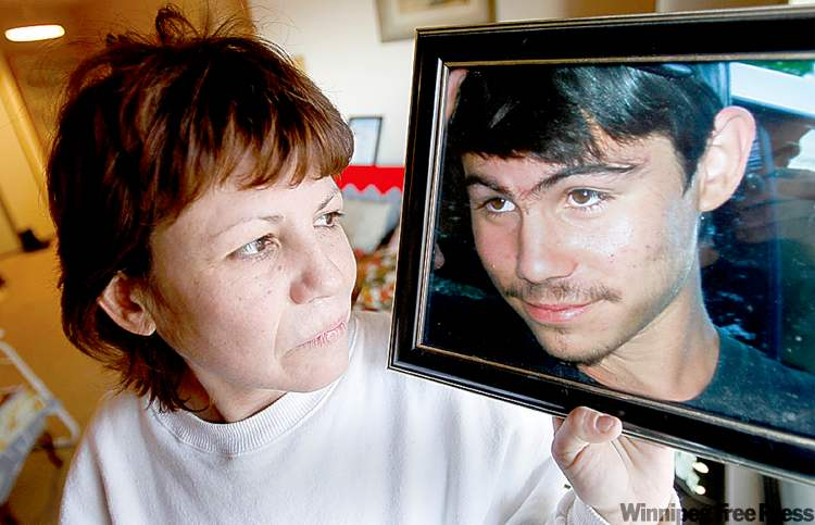 Sharon Shymko holds a photo of her son Michael Langan, who died in July 2008.