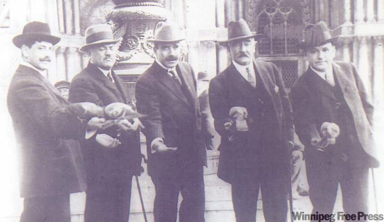 (From left to right) Hugo Ross, unidentified companion, Thomas McCaffry, Mark Fortune and Thomson Beattie, feeding the pigeons in St. Mark's Square, Venice, March 1912. PHOTO COURTESY MRS. JACK TWEDDLE/VEHICULE PRESS