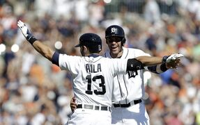 Detroit Tigers' Alex Avila (13) celebrates after hitting a walk off single to score Bryan Holladay with J.D. Martinez against the New York Yankees in the ninth inning of a baseball game in Detroit Thursday, Aug. 28, 2014. Detroit won 3-2. (AP Photo/Paul Sancya)