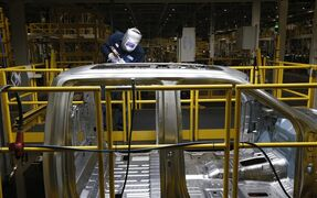 In this Nov. 11, 2014 photo, Ron Hudgins welds a 2015 Ford F-150 cab at the Dearborn Truck Plant in Dearborn, Mich. The Institute for Supply Management, a trade group of purchasing managers, issues its index of manufacturing activity for February 2015 on Monday, March 2, 2015. (AP Photo/Paul Sancya)
