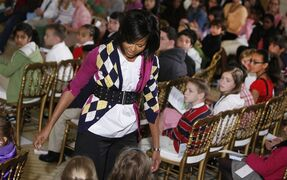 FILE - In this April 23, 2009, file photo, first lady Michelle Obama speaks to children of executive office employees in the East Room of the White House in Washington, during the White House's annual