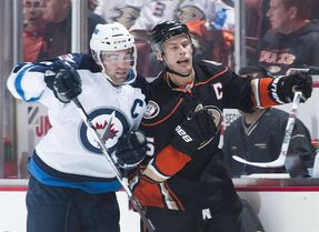 Anaheim Ducks' Ryan Getzlaf is checked by the Winnipeg Jets' Andrew Ladd during the first period of Game 1 of the Western Conference Semifinals at Honda Center Thursday night April 16, 2015. Ladd, Getzlaf and Jonathan Toews of the Chicago Blackhawks have been named the three finalists for the Mark Messier Leadership Award. THE CANADIAN PRESS/ The Orange County Register, Kevin Sullivan via AP