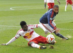 New York Red Bulls defender Ambroise Oyongo, left, tackles New England Revolution Andrew Farrell during the second half of an MLS Eastern Conference Finals soccer match Sunday, Nov. 23, 2014, in Harrison, N.J. The Montreal Impact traded midfielder Felipe to the New York Red Bulls on Tuesday in exchange for Oyongo and midfielder Eric Alexander. THE CANADIAN PRESS/AP/Bill Kostroun