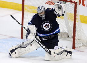 Winnipeg Jets goalie Ondrej Pavelec snaps the glove out to stymie yet another shooter. Pavs has won four straight games.