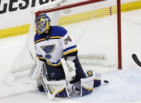 A shot by Minnesota Wild left wing Zach Parise gets by St. Louis Blues goalie Jake Allen (34) during the first period of Game 6 of an NHL hockey first-round playoff series in St. Paul, Minn., Sunday, April 26, 2015. (AP Photo/Ann Heisenfelt)
