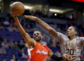 Los Angeles Clippers' Chris Paul (3) drives past Phoenix Suns' Archie Goodwin (20) during the second half of an NBA basketball game Tuesday, April 14, 2015, in Phoenix. The Clippers defeated the Suns 112-101. (AP Photo/Ross D. Franklin)