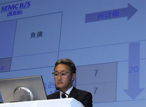 In this Wednesday, Sept. 17, 2014 photo, Sony Corp. President Kazuo Hirai watches a data during a press conference at the company's headquarters in Tokyo. Sony's losses ballooned to 136 billion yen ($1.2 billion) last quarter as the Japanese electronics and entertainment company's troubled mobile phone division reported huge red ink. The poor result released Friday, Oct. 31, 2014 was despite a 7 percent increase in quarterly sales to 1.9 trillion yen ($17.3 billion) as performance improved in cameras, TVs and game businesses. The Japanese characters in the background reads: