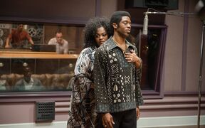 This image released by Universal Pictures shows Jill Scott, left, and Chadwick Boseman in a scene from