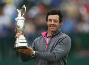 Rory McIlroy of Northern Ireland holds up the Claret Jug trophy after winning the British Open Golf championship at the Royal Liverpool golf club, Hoylake, England, Sunday.  McIlroy shot a final round of 71 to seal his victory at the Open.  The 25-year-old was 17 under par for the tournament.