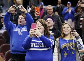 Kentucky fans take cell phone photos during the Wildcat's practice at the NCAA college basketball tournament, Wednesday, March 25, 2015, in Cleveland. Kentucky plays West Virginia in a regional semifinal on Thursday. (AP Photo/Tony Dejak)