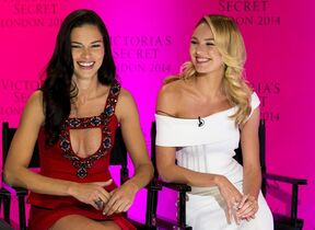 Victoria's Secret models Adriana Lima and Candice Swanepoel during a press conference at the Victoria's Secret New Bond Street store in central London, Tuesday, April 15, 2014, The Victoria's Secret models have announced that the Victoria's Secret Fashion show will be coming to London this year. (Photo by John Phillips/Invision/AP)