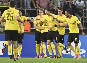 Dortmind players celebrate scoring 1-0 during the Group D Champions League match between Anderlecht and Borussia Dortmund at Constant Vanden Stock Stadium in Brussels, Belgium, Wednesday Oct. 1, 2014. (AP Photo/Geert Vanden Wijngaert)