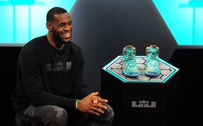 LeBron James laughs as he answers a question during the introduction of the LeBron 12 shoe at the Nike World Headquarters in Beaverton, Ore., on Tuesday, Sept. 16, 2014. (AP Photo/Steve Dykes)