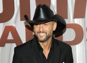 "FILE - In this Nov. 9, 2011 file photo, country singer Tim McGraw arrives at the 45th Annual CMA Awards in Nashville, Tenn. The duet on his new album, ""Sundown Heaven Town,"" out on Sept. 16, 2014 marks his 50th top 10 entry into Billboard's Hot Country chart and further emphasizes how important family is to McGraw, both his own kinfolk and his ever growing musical family. (AP Photo/Evan Agostini, file)"