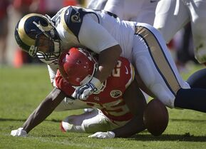 FILE - In this Oct. 26, 2014, file photo, Kansas City Chiefs running back Jamaal Charles (25) fumbles the ball while being tackled by St. Louis Rams defensive tackle Aaron Donald (99) during an NFL football game in Kansas City, Mo. Donald has won The Associated Press NFL Defensive Rookie Of The Year award for 2014. (AP Photo/Reed Hoffmann, File)