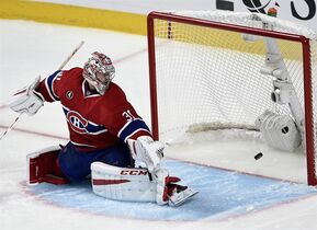 Montreal Canadiens goalie Carey Price lets in the winning goal by Tampa Bay Lightning right wing Nikita Kucherov during the second overtime period in Game 1 NHL second round playoff hockey action Friday, May 1, 2015 in Montreal.THE CANADIAN PRESS/Ryan Remiorz