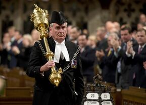 The Sergeant-at-Arms Kevin Vickers receives a standing ovation as he enters the House of Commons Thursday October 23, 2014 in Ottawa. Vickers was among those who opened fire Wednesday on the gunman who stormed Parliament Hill. THE CANADIAN PRESS/Adrian Wyld