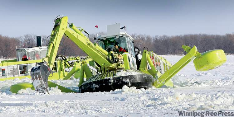 Amphibex machines work on the Red River north of Selkirk Tuesday morning. Two of the province's three units are capable of performing dredging work as well as their usual icebreaking duty.