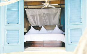 The luxurious accommodations next to the ocean at Cayo Espanto, Belize.