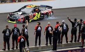 Jeff Gordon celebrates in front of his crew after winning the NASCAR Brickyard 400 auto race at Indianapolis Motor Speedway in Indianapolis, Sunday, July 27, 2014. (AP Photo/Dave Parker)