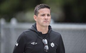 Canadian women's soccer team head coach John Herdman looks on during a training session in Vancouver, B.C. Wednesday, April 21, 2015. The Canadian women's soccer team, which went from last at the 2011 World Cup to the medal podium at the 2012 London Olympics, unveils its roster Monday for this summer's World Cup campaign. THE CANADIAN PRESS/Jonathan Hayward