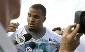 Miami Dolphins player Mike Pouncey (51) talks to the media after NFL football training camp Friday, July 25, 2014, in Davie, Fla. (AP Photo)