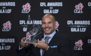 Jon Cornish of the Calgary Stampeders celebrates his most outstanding Canadian player of the year award during the CFL Awards in Vancouver, B.C. Thursday, Nov. 27, 2014. THE CANADIAN PRESS/Jonathan Hayward