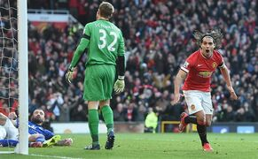 Manchester United's Radamel Falcao, right, celebrates scoring his team's second goal against Leicester City, during their English Premier League soccer match at Old Trafford, Manchester, England, Saturday, Jan. 31, 2015. (AP Photo/Martin Rickett, PA Wire) UNITED KINGDOM OUT - NO SALES - NO ARCHIVES