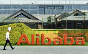A chef walks in the headquarter campus of Alibaba Group in Hangzhou, China on Aug. 27, 2014. THE CANADIAN PRESS/AP, file