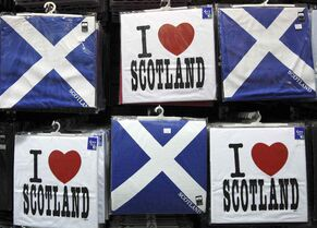 A display of t-shirts are seen for sale in a Scottish memorabilia shop in Edinburgh, Scotland Friday, Jan. 13, 2012.