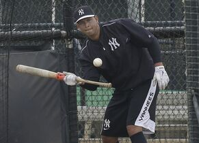 New York Yankees third baseman Alex Rodriguez bunts in the batting cage while working out at the Yankees' minor league complex Wednesday, Feb. 25, 2015, in Tampa, Fla. (AP Photo/Chris O'Meara)