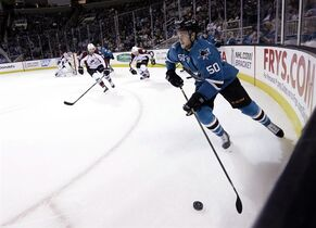 San Jose Sharks' Chris Tierney (50) works against the Colorado Avalanche during the first period of an NHL hockey game Wednesday, April 1, 2015, in San Jose, Calif. (AP Photo/Marcio Jose Sanchez)