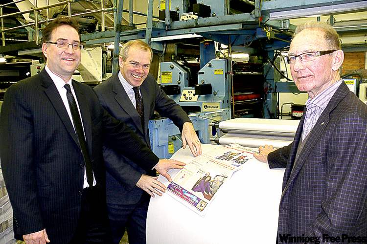 FPLP executive Dan Koshowski (left) and Free Press publisher Bob Cox look over a copy of The Carillon along with Rick Derksen (right) Monday in Steinbach.