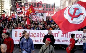 CGIL union workers union march during a demonstration to protest Premier Matteo Renzi's labor reforms, in Rome, Saturday, Oct. 25, 2014. (AP Photo/Andrew Medichini)