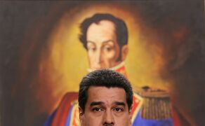 """FILE - In this Dec. 30, 2014 file photo, Venezuela's President Nicolas Maduro, backdropped by a painting of independence hero Simon Bolivar, speaks during a press conference at Miraflores Presidential Palace in Caracas, Venezuela. Fears that falling oil prices could knock the wheels off the already wobbly economy of oil-dependent Venezuela have sparked apparent interest in alternatives to Petrocaribe, a trade program created by the late President Hugo Chavez that has kept the region dependent on the South American country for energy. At the moment, there is no sign that Venezuela will end Petrocaribe. Earlier this month, Maduro praised it as a """"guarantee of peace, stability, mutual benefit, shared development and fair commerce shared by the entire Caribbean."""" (AP Photo/Ariana Cubillos,File)"""