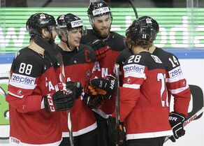 Canada's Sidney Crosby, second from left, celebrates with teammates (left to right) Brent Burns, Ryan O'Reilly, Claude Giroux and Jordan Eberle after scoring against the Czech Republic during the Hockey World Championships Group A match in Prague, Czech Republic, Monday, May 4, 2015. (AP Photo/Petr David Josek)