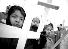 Members of the  Pimicikamak Cree Nation carry white crosses during a protest at Hydro's Jenpeg dam in 2007.