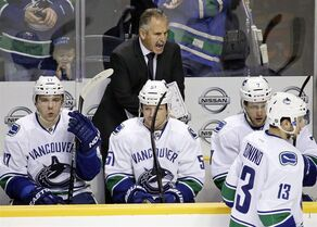 Vancouver Canucks head coach Willie Desjardins yells to his players in the second period of an NHL hockey game against the Nashville Predators Tuesday, Jan. 13, 2015, in Nashville, Tenn. Coming off an uninspired loss in the first game after the NHL all-star break, Willie Desjardins had a pointed chat with his Vancouver Canucks on Wednesday morning. THE CANADIAN PRESS/AP, /Mark Humphrey