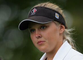 Brooke Henderson of Canada walks from the tee, after her shot on the10th hole, during final round play at the Canadian Pacific Women's Open golf tournament in London, Ont., on Sunday, Aug. 24, 2014. Henderson is turning pro.The Canadian teenage golf sensation announced Thursday she will join the LPGA Tour in 2015 instead of attending the University of Florida. THE CANADIAN PRESS/Dave Chidley