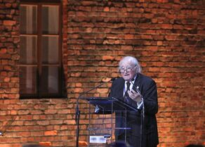 Polish born Holocaust survivor Roman Kent speaks in a tent raised at the entrance of the Birkenau Nazi death camp in Oswiecim, Poland, Tuesday, Jan. 27, 2015, during the official remembrance ceremony. About 300 survivors gathered with leaders from around the world to remember the 1.1 million people killed at Auschwitz-Birkenau and the millions of others killed in the Holocaust.(AP Photo//Czarek Sokolowski)