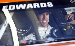 Driver Carl Edwards waits to leaves the garage to practice for Sunday's NASCAR Sprint Cup Series auto race, Saturday, Feb. 28, 2015, in Hampton, Ga. (AP Photo/John Bazemore)