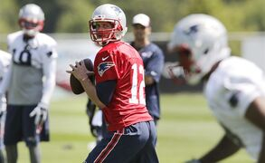 New England Patriots quarterback Tom Brady sets to throw a pass during an NFL football practice in Foxborough, Mass., Wednesday, Aug. 20, 2014. (AP Photo/Charles Krupa)