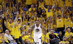 The crowd celebrates after a 3-point basket by Golden State Warriors' Andre Iguodala (9) during the second half in Game 1 of the NBA basketball playoffs Saturday, April 18, 2015, in Oakland, Calif. Golden State won 106-99. (AP Photo/Marcio Jose Sanchez)