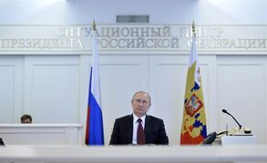 Russian President Vladimir Putin watches the launch of the largest gas field on the Yamal Peninsula, Gazprom's gas field No. 1 at the Bovanenkovo deposit, via a video link at the Russian Presidential Situation center in the Kremlin in Moscow, Russia, Monday, Dec. 22, 2014. (AP Photo/RIA Novosti, Alexei Druzhinin, Presidential Press Service)