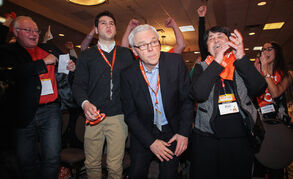 Greg Selinger with a look of relief stands up while his wife Claudette Toupin (right) celebrates his re-election as the leader of the provincial NDP on sunday at the NDP Convention at Canad Inns Polo Park.150308 - Sunday, March 08, 2015 - (MIKE DEAL / WINNIPEG FREE PRESS)
