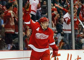 Detroit Red Wings center Pavel Datsyuk (13) celebrates scoring a goal against the Philadelphia Flyers in the second period of an NHL hockey game in Detroit Wednesday, Nov. 26, 2014. (AP Photo/Paul Sancya)